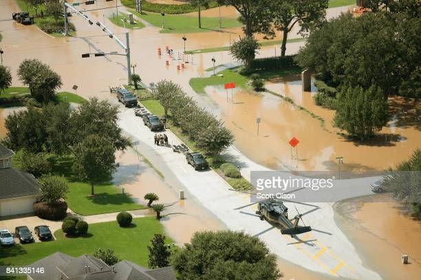 S Customs and Border Protection helicopter crew searches checks on flood victims after torrential rains pounded the area following Hurricane then...