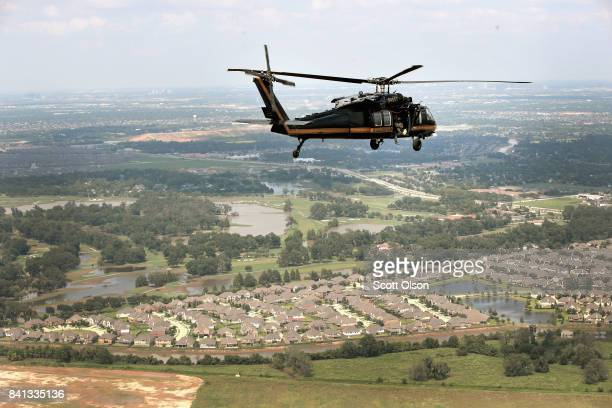S Customs and Border Protection helicopter crew searches for flood victims after torrential rains pounded the area following Hurricane then Tropical...