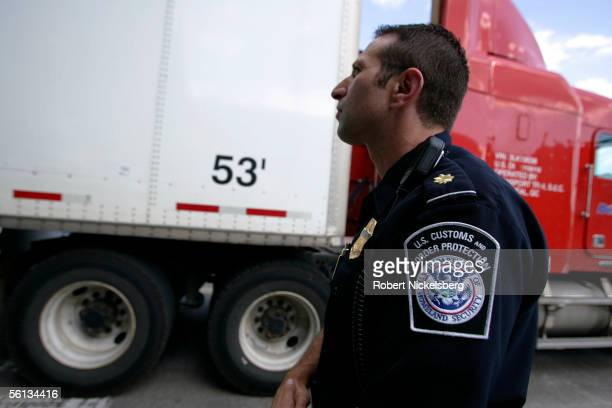 US Customs and Border protection officer checks a tractortrailer for clearance after crossing from Canada on September 20 2005 in Buffalo New York...