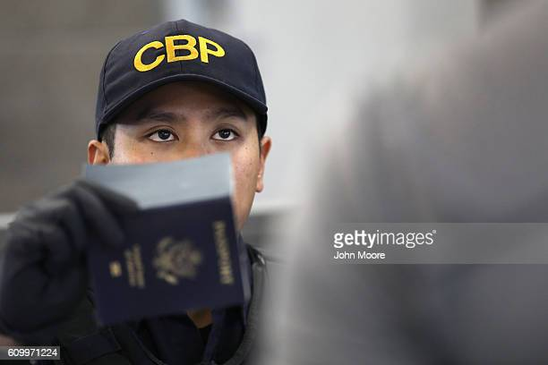 S Customs and Border Protection officer checks identifications as people cross into the United States from Mexico on September 23 2016 in San Ysidro...