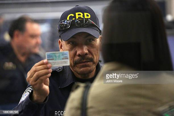 S Customs and Border Protection officer checks the identification of a person crossing from Mexico into the United States at the San Ysidro port of...
