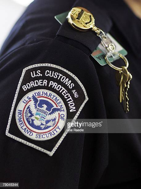 Customs and Border Protection officer works at the passport control area January 19 2007 at Miami International Airport in Miami Florida Starting...