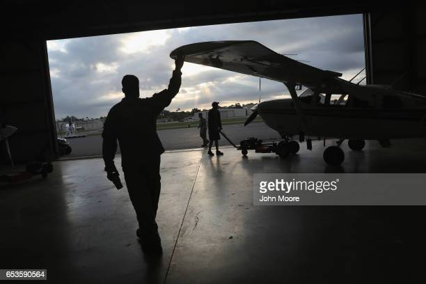 S Customs and Border Protection pilot helps guide a airplane out of the hangar before an air patrol over the USMexico border on March 15 2017 in...