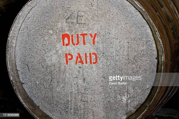 Customs and excise duty paid printed on a barrel in a distillery, Isle of Islay, Scotland