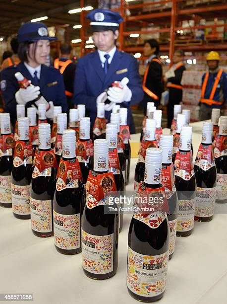 Customs officers check bottles of Beaujolais nouveau at Kansai International Airport on November 4 2014 in Izumisano Osaka Japan The wine is released...
