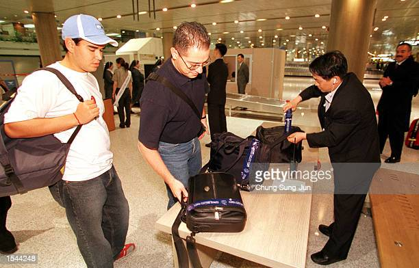 Customs officials check bags at Incheon International Airport May 21 2002 in Incheon South Korea The government is stepping up security ahead of the...