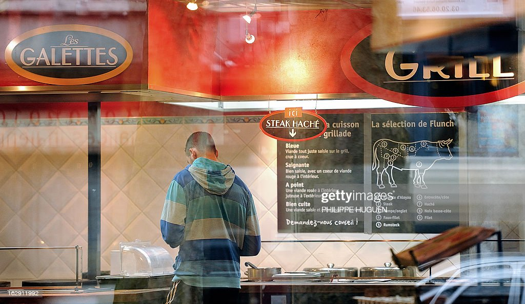 A custumer waits to be served in a Flunch restaurant on March 1, 2013 in Villeneuve-d'Asq. Flunch suspended supplying meat from Castel Viande, after this supplier was investigated for deception on the origin of the meat.