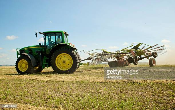 Cut alfalfa is raked into rows before being baled on the Freeburg Hay Farm in Gayville South Dakota US on Monday Aug 18 2008 Net farm income in 2008...