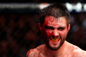 A cut and bloodied Carlos Condit reacts after a round against Georges StPierre in their welterweight title bout during UFC 154 on November 17 2012 at...