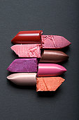 Cut and Stacked Lipsticks on Grey Background