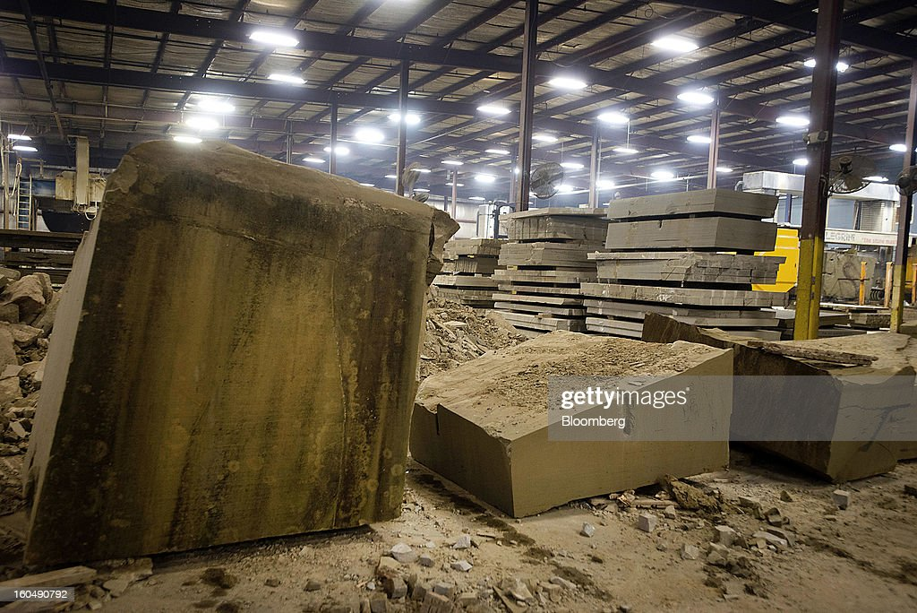 Cut and uncut blocks of sandstone sit stacked inside the fabrication area at the Cleveland Quarries facility in Vermilion, Ohio, U.S., on Friday, Feb. 1, 2013. Spending on U.S. construction projects climbed more than forecast in December, showing the housing industry is sustaining gains that may lift the economy. Photographer: Ty Wright/Bloomberg via Getty Images