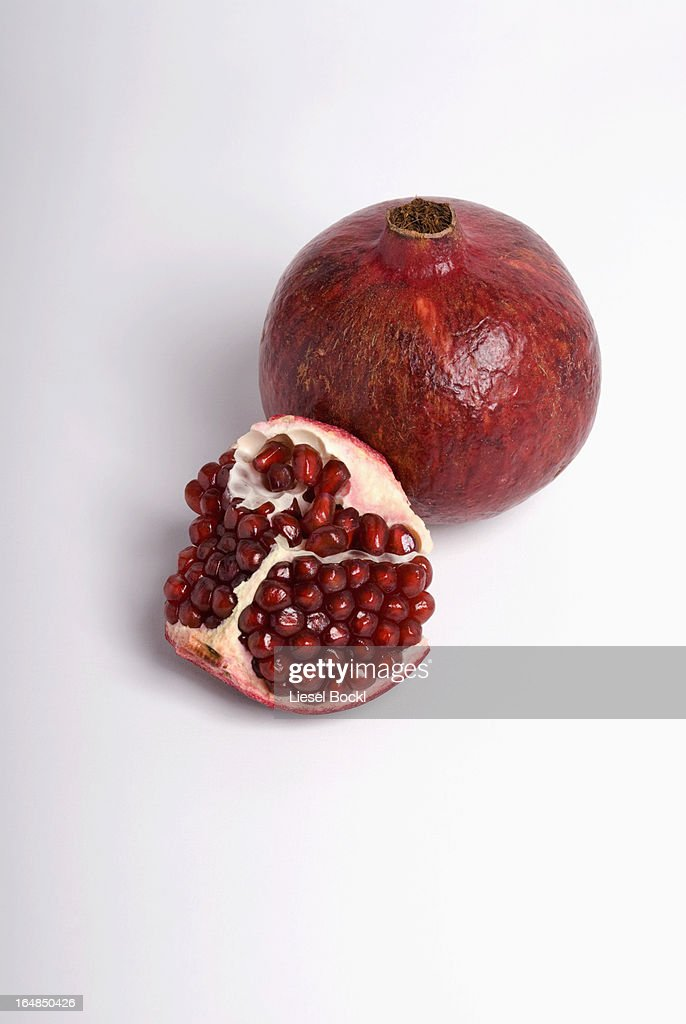 Cut and whole pomegranate