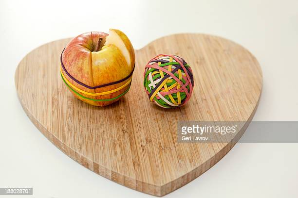 Cut apple and ball of rubber bands