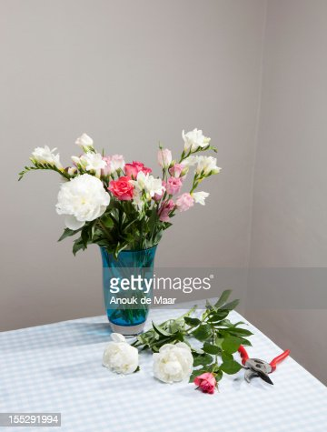 Cut flowers with bouquet in vase : Stock Photo