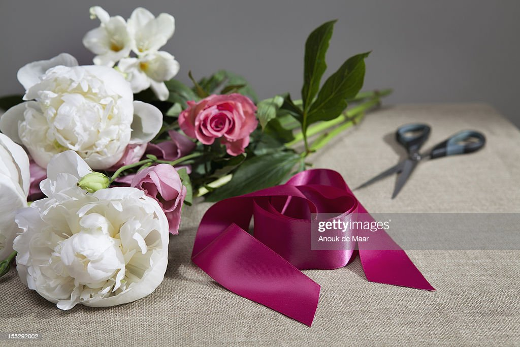 Cut flowers with shears and ribbon : Stock Photo