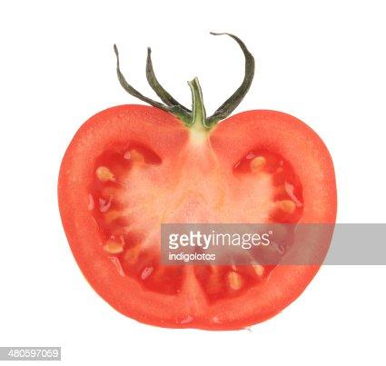 Cut half tomato. : Stock Photo
