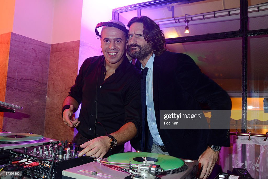 DJ Cut Killer and <a gi-track='captionPersonalityLinkClicked' href=/galleries/search?phrase=Frederic+Beigbeder&family=editorial&specificpeople=2164723 ng-click='$event.stopPropagation()'>Frederic Beigbeder</a> attend the Prix de Flore 2013' : Ceremony Cocktail At Cafe De Flore on November 7, 2013 in Paris, France.