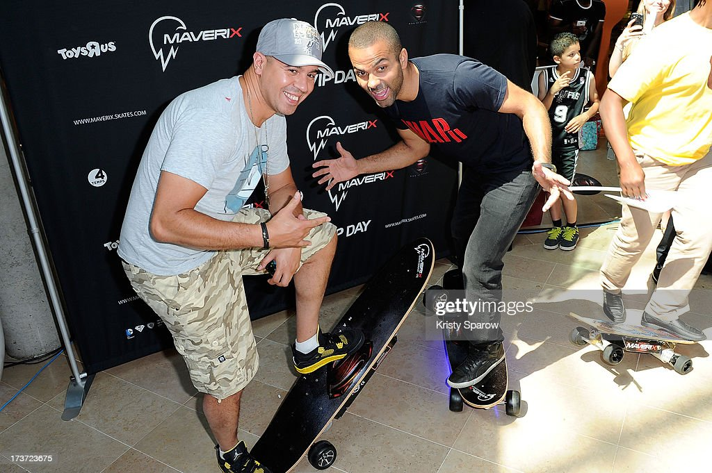 Cut Killer and Tony Parker attend the Maverix Electric Skate presentation at La Defense in Paris at La Defense on July 17, 2013 in Paris, France.