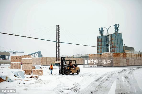 Cut lumber sits in the mill yard in preparation for drying in the wood kiln at the Resolute Forest Products facility in Thunder Bay Canada Ontario on...