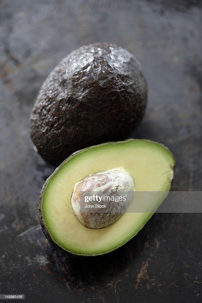 Cut open avocado : Stock Photo