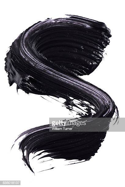 A cut out beauty product shot of black mascara