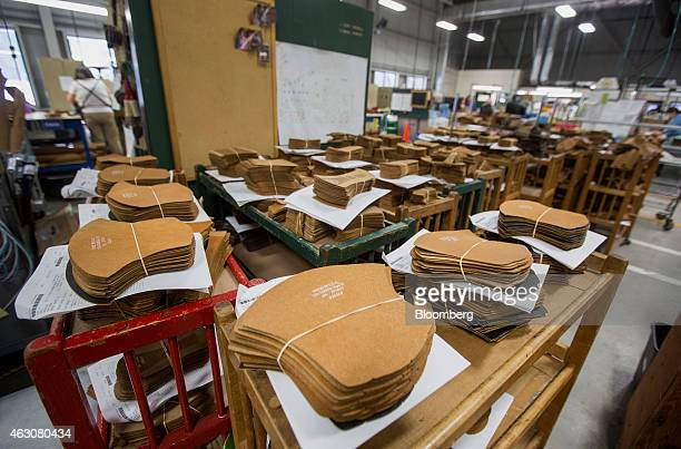 Cut out pieces of leather sits in piles before being made into boots at the LL Bean Inc manufacturing facility in Brunswick Maine US on Friday Feb 6...