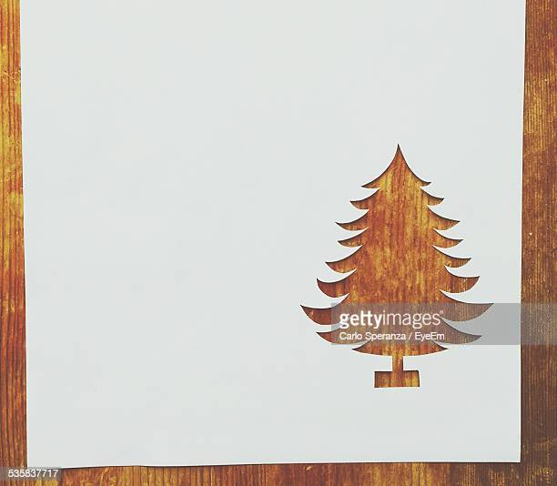 Cut Paper In Christmas Tree Shape On Table