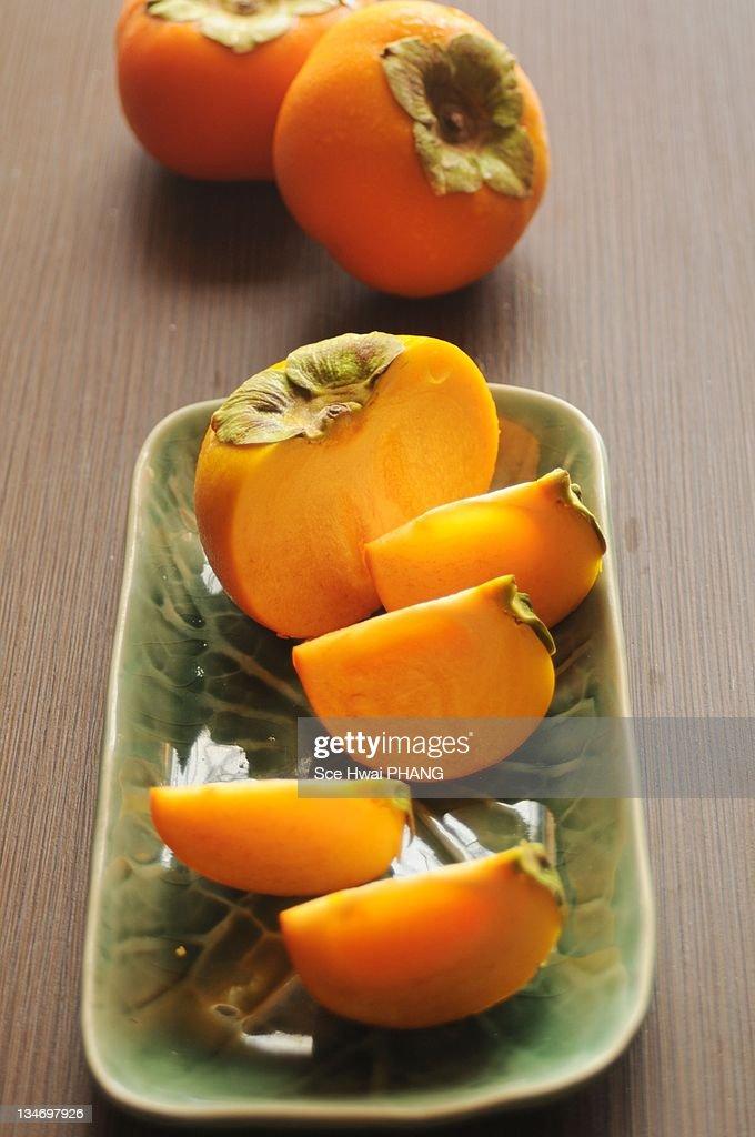 Cut persimmons : Stock Photo