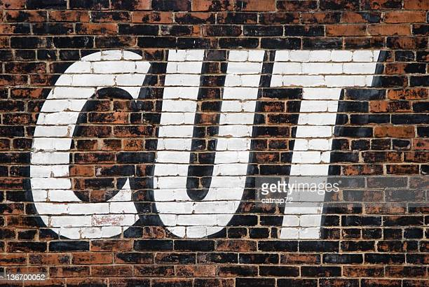 Cut Sign, Word Painted Large on Brick Wall