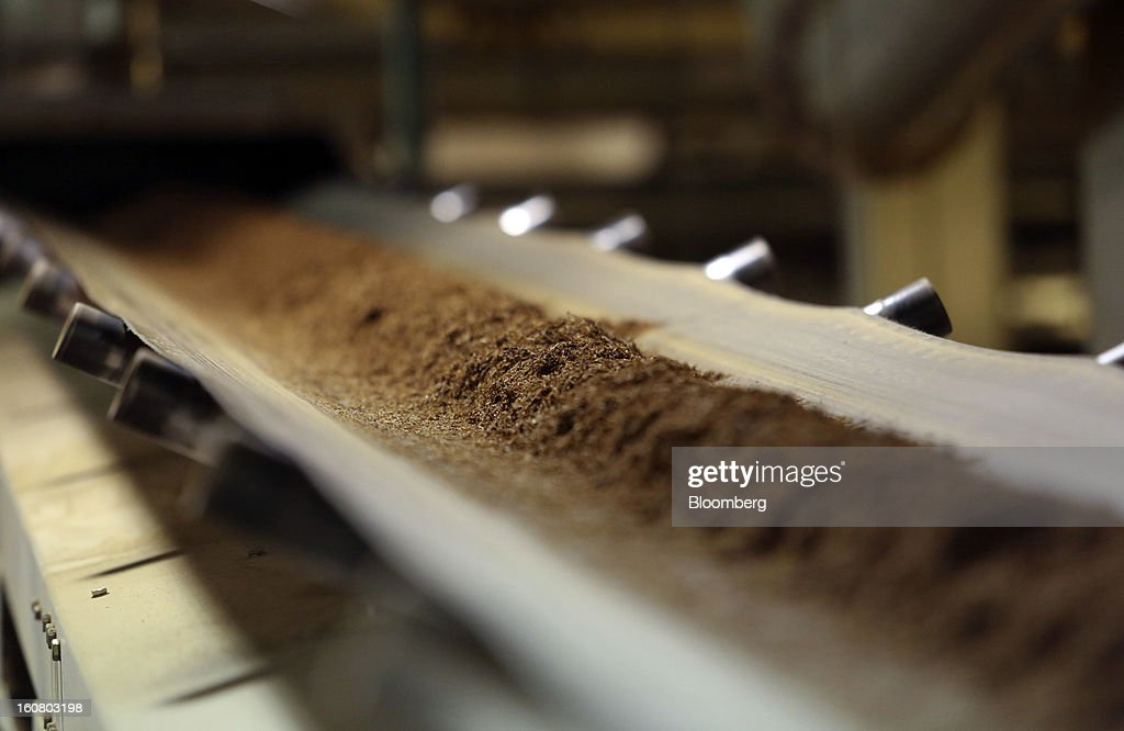 Cut tobacco leaves pass along a conveyor belt ahead of cigarette manufacture at Imperial Tobacco Group Plc's factory in Nottingham, U.K., on Friday, Feb. 1, 2013. Imperial Tobacco Group Plc is Europe's second-biggest tobacco company and generates about 40 percent of its profit from the region. Photographer: Chris Ratcliffe/Bloomberg via Getty Images