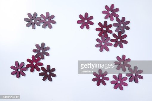 Cut wooden decorative flowers on white background : Photo