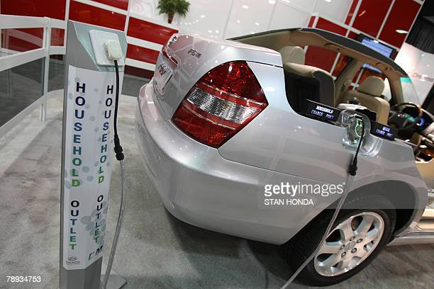A cutaway demonstration model of the F6 DM car from BYD Company Ltd of China showing a place where ordinary household electricity can be plugged in...