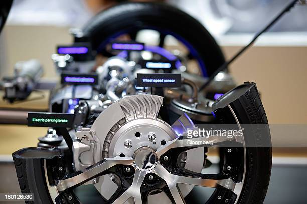 A cutaway display of a disk braking system and alloy wheel are seen at the 65th Frankfurt International Motor Show in Frankfurt Germany on Monday...