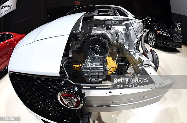 A cutaway of a Jaguar S AWD is introduced during the first press preview day at the 2015 New York Auto Show April 1 2015 at the Jacob Javits Center...