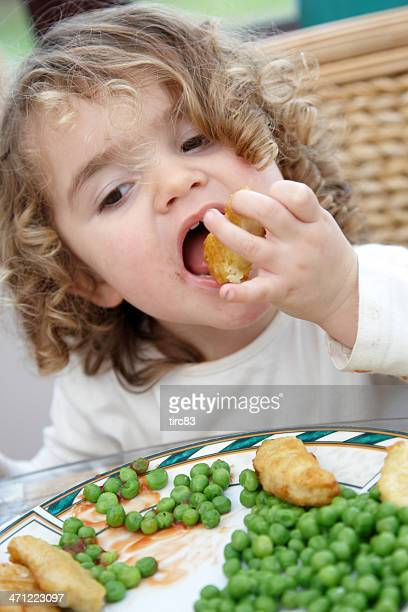 Cute 3 year old girl eating