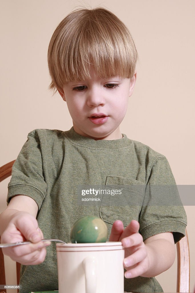 4 Year Boy Bedroom Decorating Ideas: A Cute 4 Year Old Boy Coloring An Easter Egg Stock Photo