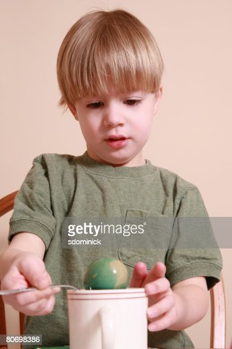 Adorable Four Year Boy With Big Blue Eyes Stock Image: A Cute 4 Year Old Boy Coloring An Easter Egg Stock Photo
