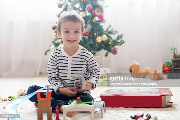 Cute adorable boy, playing with toys on Christmas