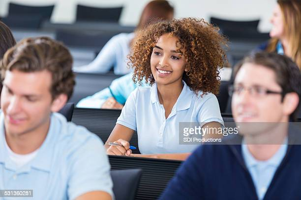Cute African American college prep school student in classroom
