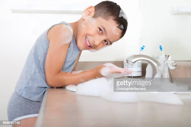 Cute asian boy washing hands
