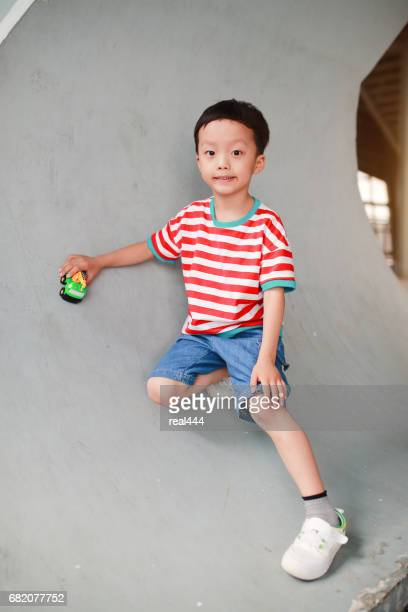 Cute Asian children and toy car