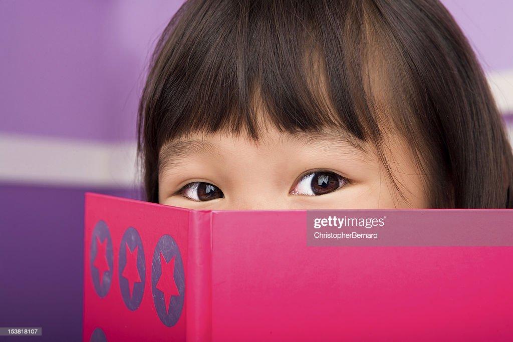 adorable asian escort reading