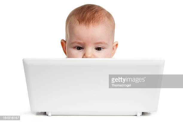 Cute Baby behind laptop