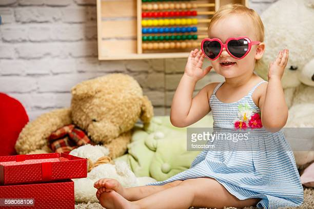 Cute baby girl playing in her room