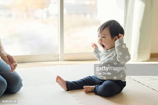 Cute baby girl playing in home