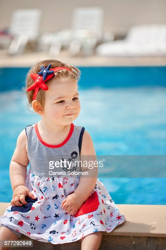 Cute Baby Girl Sitting Near The Swimming Pool Stock Photo Getty Images