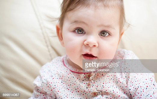 Cute Baby Girl With Green Eyes Looking At Camera Stock ...