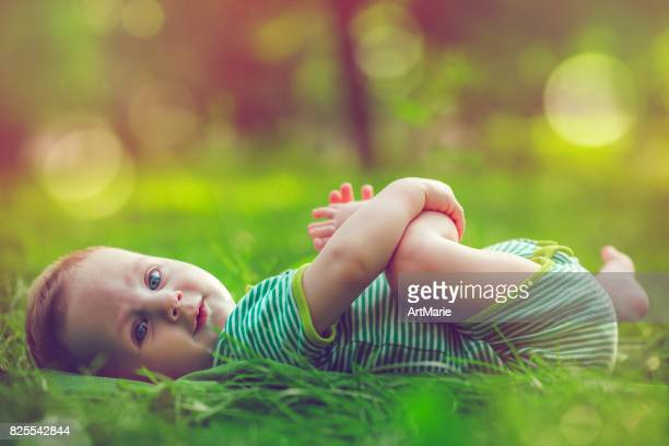 Cute baby outdoors in summer
