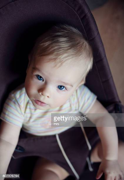 Cute baby sitting in baby bouncer