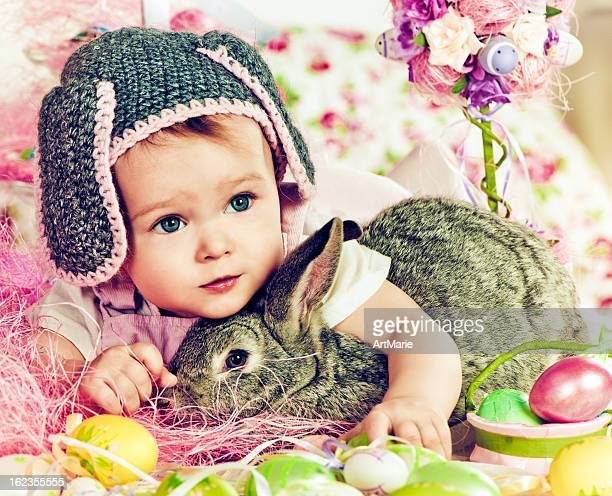 Cute baby with Easter bunny